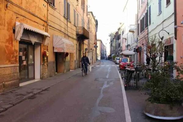 A man bikes in Ferrara