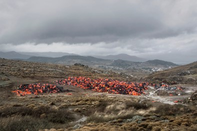 Alessandro Penso-Refugees in Bulgaria, Molyvos, Lesvos, Oct. 23, 2015. A garbage dump near the town of Molyvos with thousands of discarded life jackets, used by refugees and migrants during their journey to Europe.
