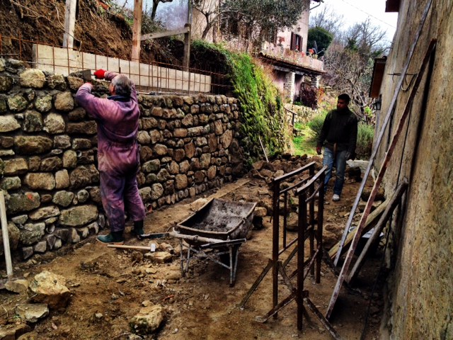 "The ""new"" old wall is reinforced and is being carefully constructed in the best possible way (including new drainage). And what a handsome wall it will be!"