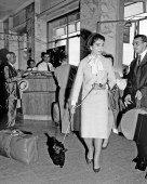 """Soprano Maria Meneghini Callas walks through Ciampino Airport in Rome, Italy, with her French miniature poodle """"Toy"""" on a leash, Sept. 22, 1959. Miss Callas will board a plane for London for a concert engagement tomorrow. Earlier today, Miss Callas drove to Rome from Fiumicino, a port town 15 miles from Rome. She had gone ashore there from the yacht """"Christina,"""" Greek shipping magnate Aristotle Onassis' pleasure craft, aboard which she has been a guest for some time. (AP Photo/Mario Torrisi)"""
