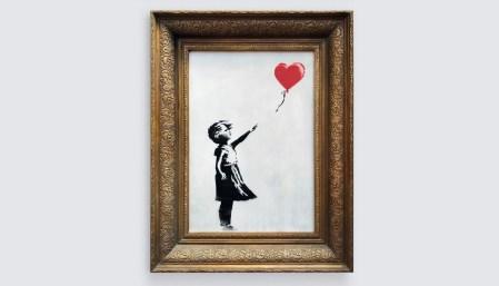 Бэнкси опубликовал режиссерскую версию видео про уничтожение своей картины «Девочка с шаром». Шредер должен был уничтожить ее полностью
