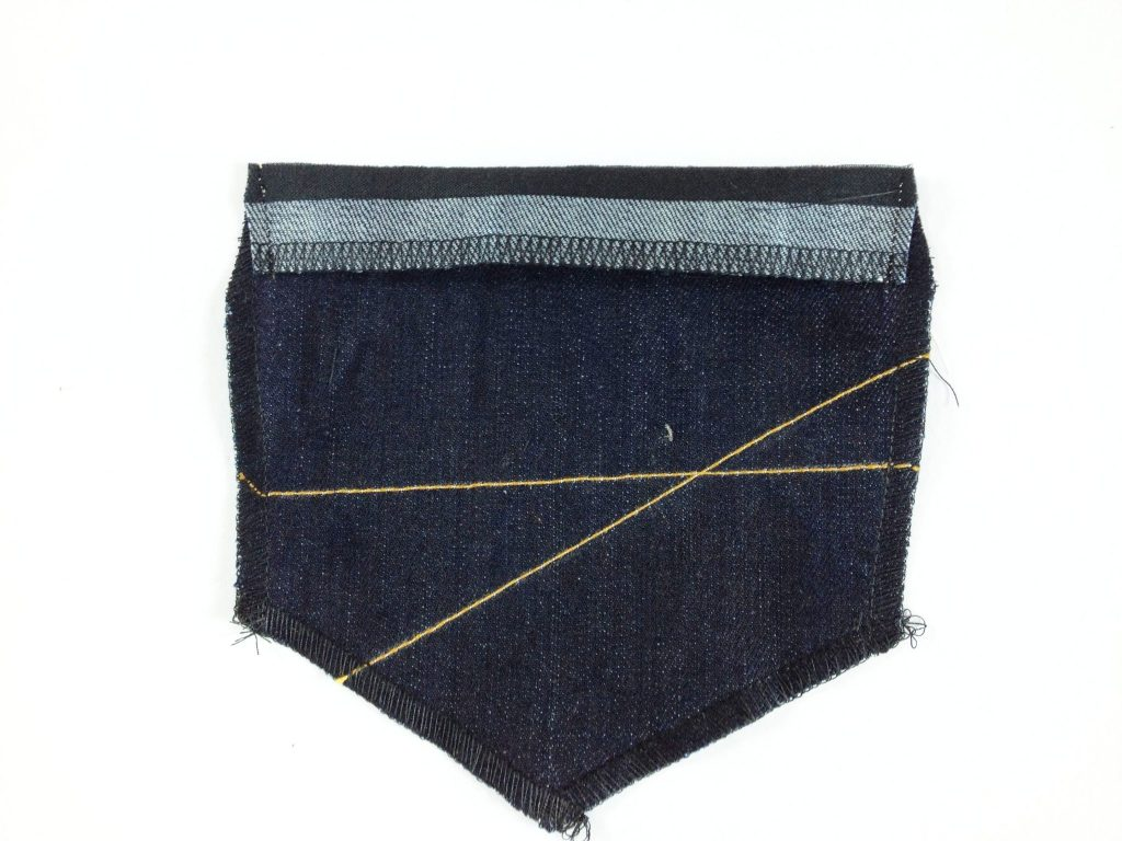 Liana Stretch Jeans Sewalong Day 6 Fold down top of pocket right sides together, stitch side seams and trim corners