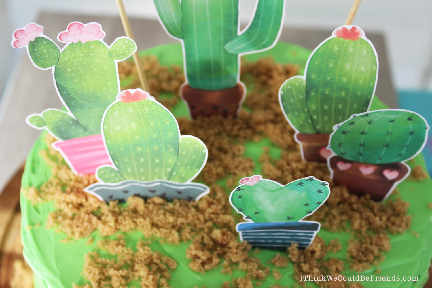 This Mother's Day Cactus Cake Topper is super EASY to make and FREE! What mom doesn't love that? You can put it on a homemade cake or store bought, just print, cut out the shapes, hot glue to skewer sticks and decorate! #mothers #day #cake #diy #decoration #topper #free #printable #cactus #succulent #easy