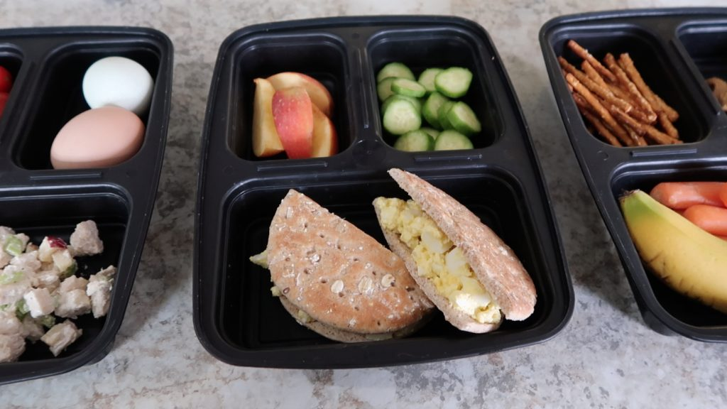 You don't need a culinary background or art degree to pack practical bento or to-go boxes as we call them! Let's talk EASY to have on hand foods that keep well and your family will ACTUALLY eat so that we can stop spending so much money on fast food and restaurants!! #bentobox #ideas #easy #practical #lunch