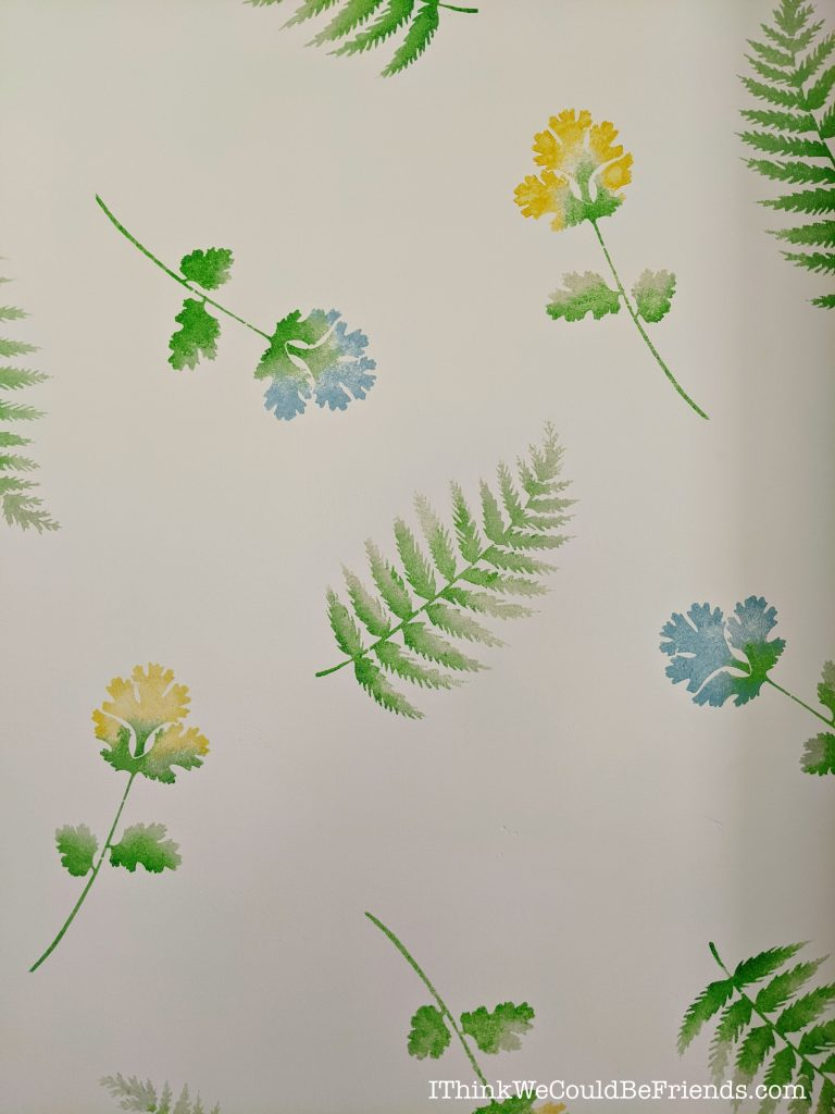 Up close of watercolor stenciled wall to look like wallpaper