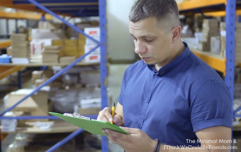 man taking inventory in warehouse