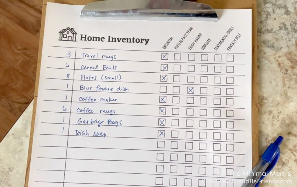 home inventory checklist on clipboard with pen