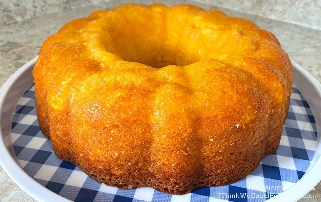 lemon bundt cake fresh out of pan on checkered platter