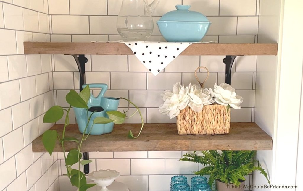 open shelving with blue decor