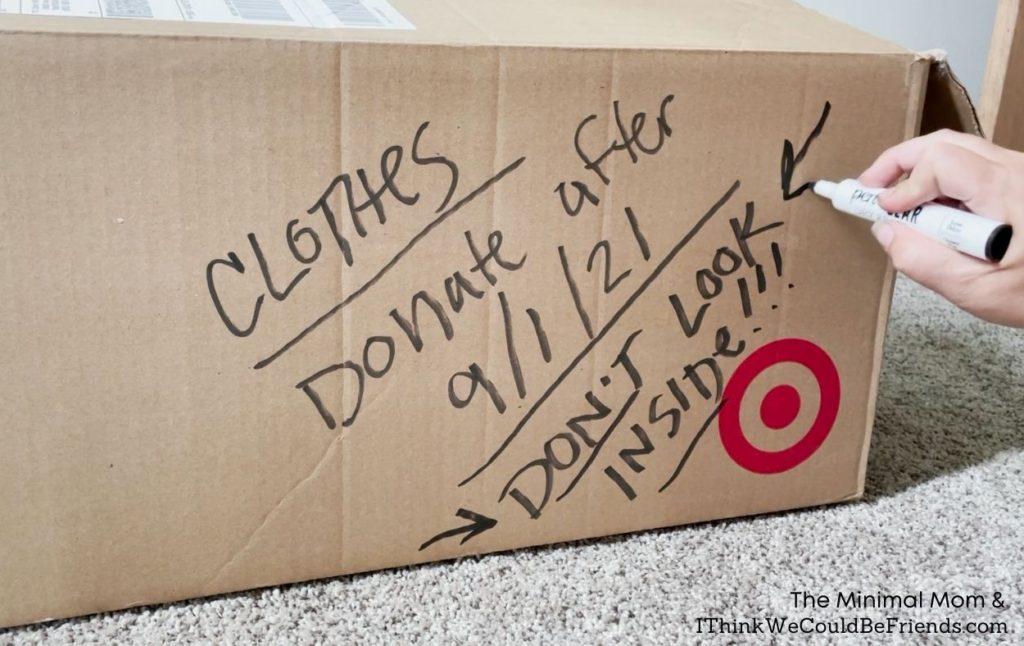 cardboard quarantine bin with donation date