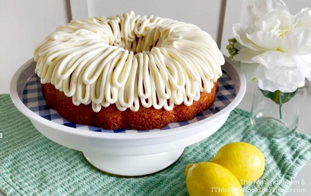 decorated lemon bundt cake on cake stand