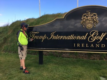 Tony decorates the golf course sign