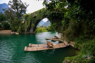 Bamboo rafts under a bridge on Yulong River