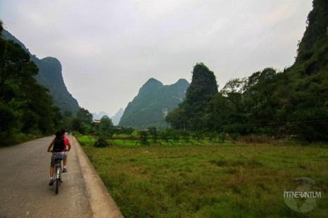 girl cycling in the countryside near Yangshuo