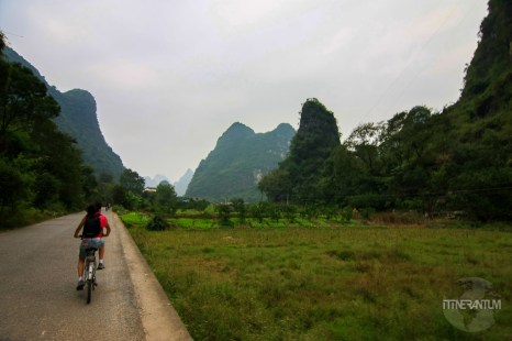 girl cycling in the countryside near Yangshuo