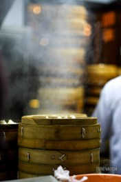 Steaming dumplings in bamboo containers