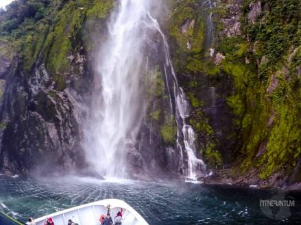 boat next to the waterfall, Milford Sound
