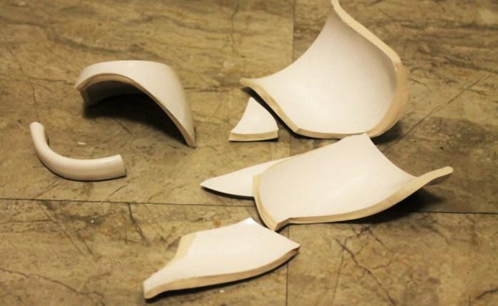 Broken Cup on Floor