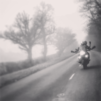 Rider and pillion in the fog