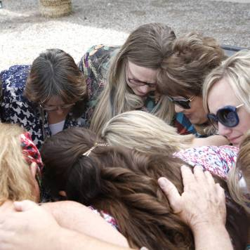 Carol Bundy, wife of rancher Cliven Bundy, third right, prays with her daughter Bailey Louge, third left, and supporters outside the Lloyd George U.S. Courthouse on Monday, April 24, 2017, in Las Vegas. Bizuayehu Tesfaye Las Vegas Review-Journal @bizutesfaye