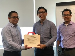 Charles Ventura receives a certificate of appreciation from Joli Patino and Bobby Espiritu