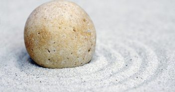 decorative image, stone resting on sand