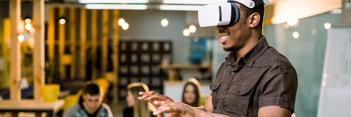 Man wearing virtual reality glasses in makerspace