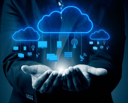 Man displaying multiple cloud services in the palm of his hand