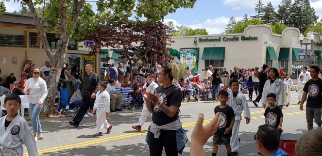 Students walk down street in parade