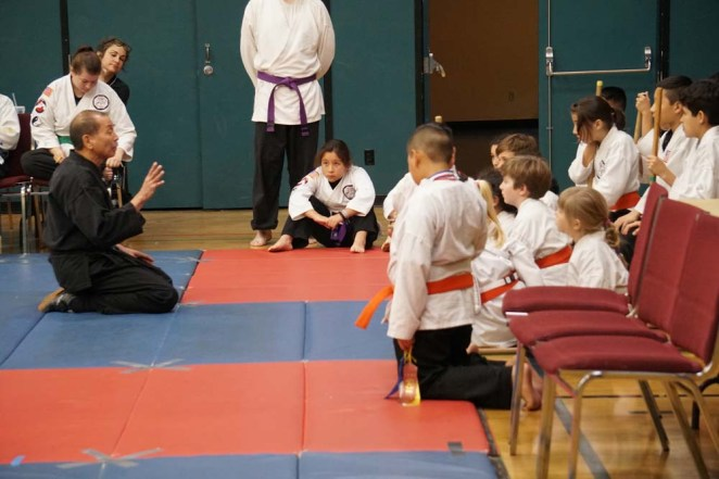 Instructor talking to kids