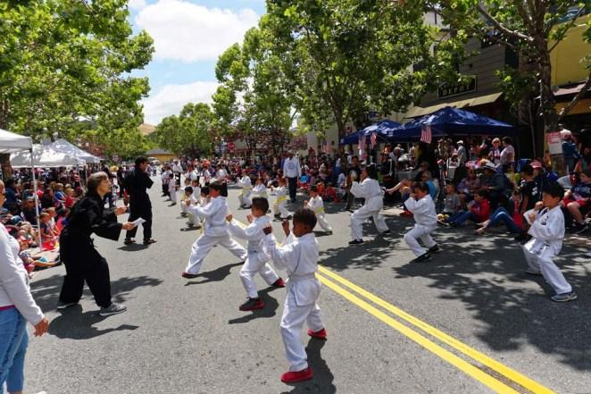 Kids giving skill demo in street