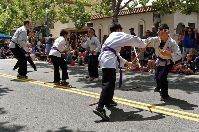 Purple belts giving weapons demo at parade