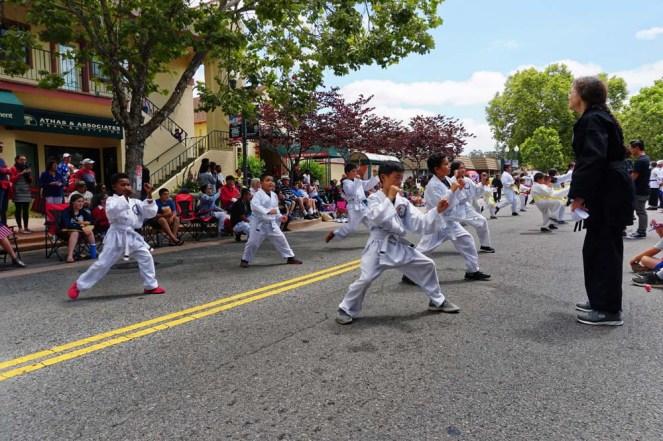 Young students performing at parade