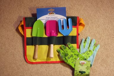 Gardening tools and gloves by Kids in the Garden