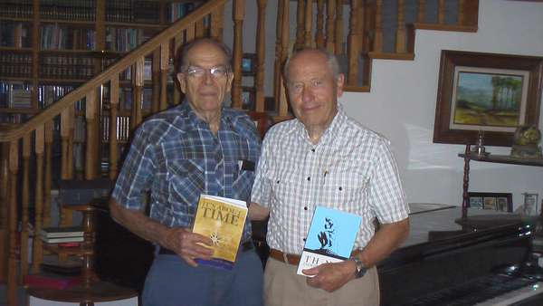 """Authors Chancey Riddle and David W. Allan sharing books. - """"Think Independently"""" and """"It's About Time."""""""