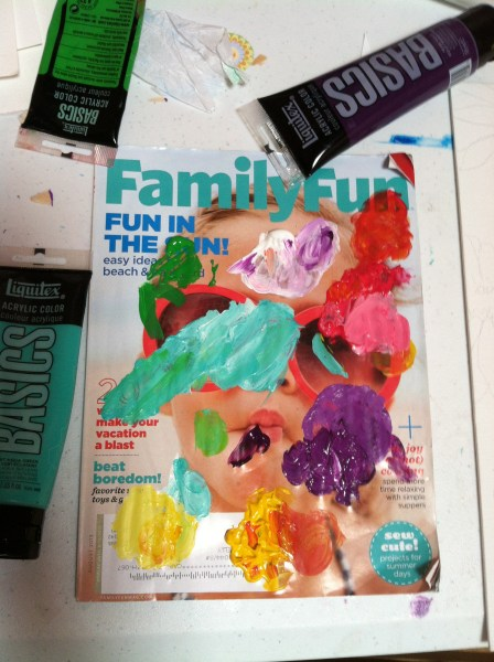 When I am waiting I am painting on magazine covers.