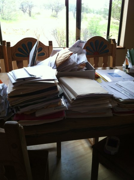 Paper piled on my table