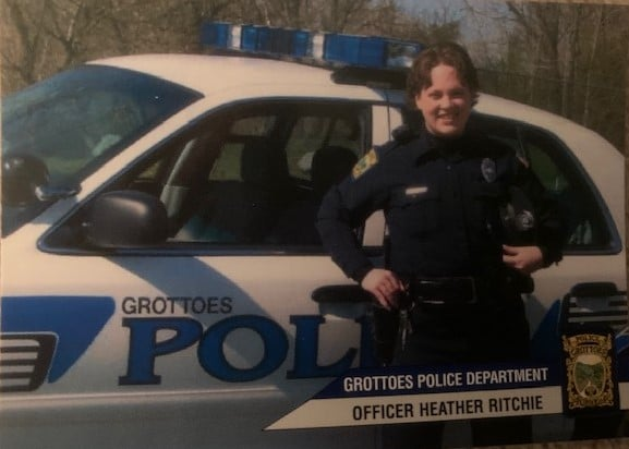 Heather as a police officer