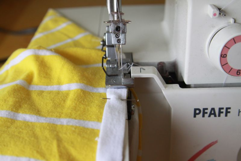 sewing on white fabric strip on sewing machine