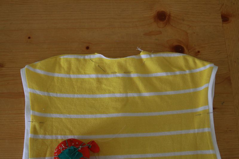 baby dress with neckline pinned