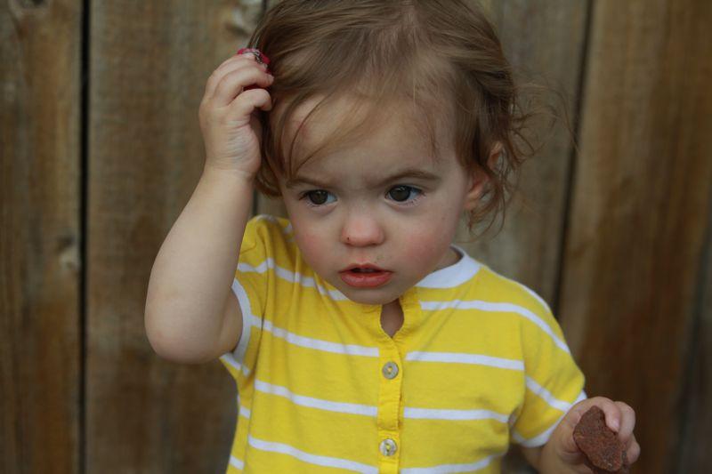 A little girl in a yellow dress
