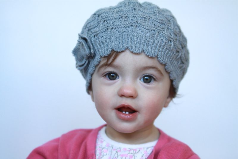 A closeup of a little girl wearing a hat