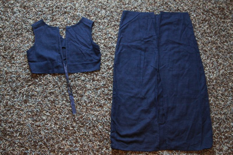 Navy blue dress cut in half at waist