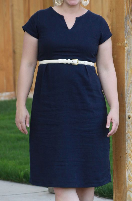 A woman wearing a refashioned navy dress