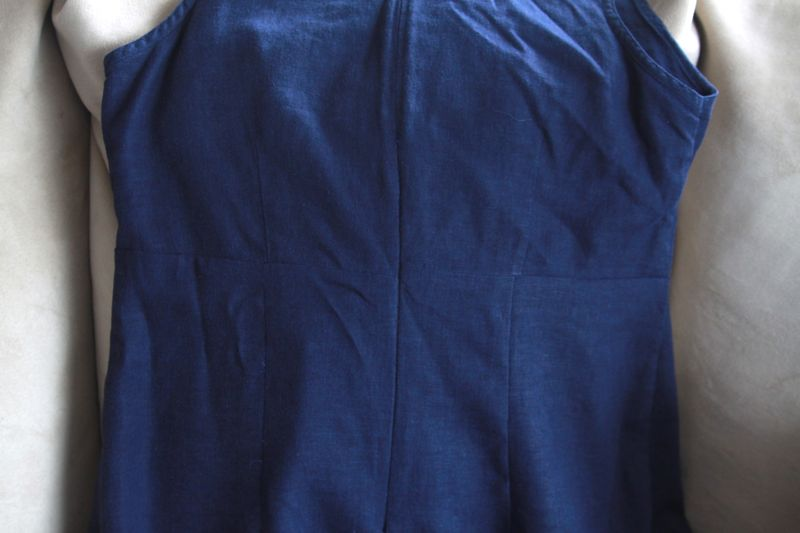 Back of navy dress with invisible zipper and darts