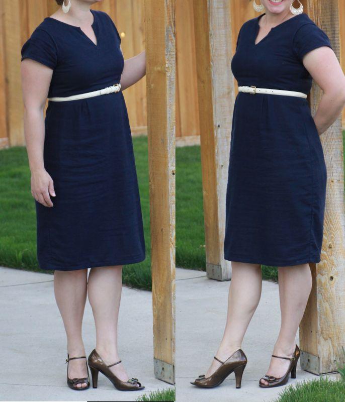 A woman wearing a navy knee length dress