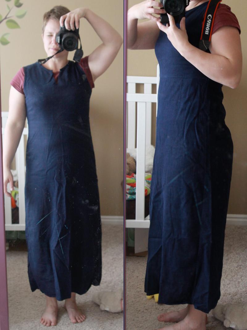 A woman wearing a long navy dress taking a selfie