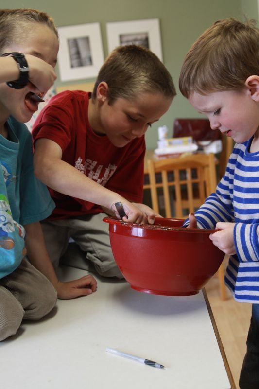 kids eating brownie batter from a bowl