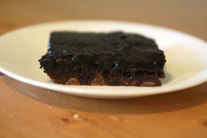 a dark chocolate brownie on a plate