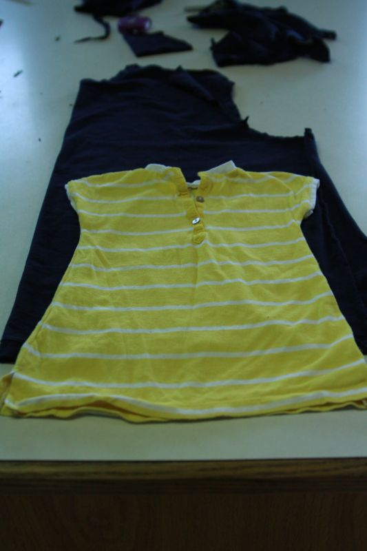 baby dress laid over fabric from t-shirt to act as pattern